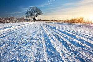 snow-covered road tractor slippage
